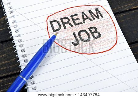 Dream Job text on notepad and blue pen