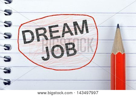 Dream Job text on notepad and red pencil