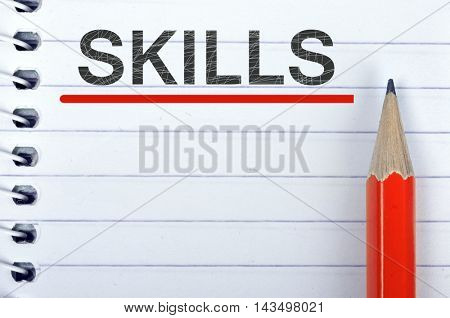 Skills text on notepad and red pencil