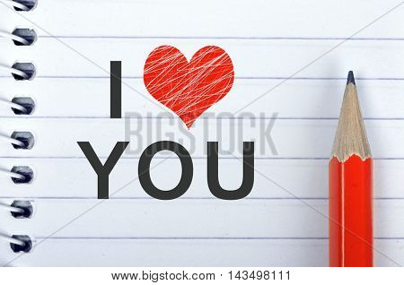 I love you text on notepad and red pencil