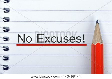 No Excuses text on notepad and red pencil