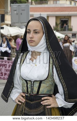 QUARTU S.E. ITALY - 15 September 2013: Grape Festival in honor of the celebration of St. Helena - Sardinia - portrait of a beautiful girl in the folk group of Isili