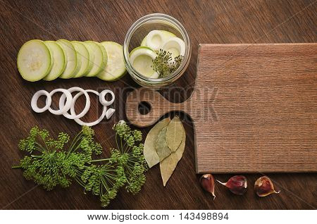 Preparation of squash for homemade preserving on wooden background