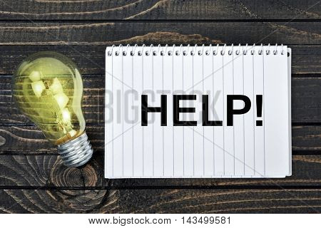 Help text on notepad and light bulb