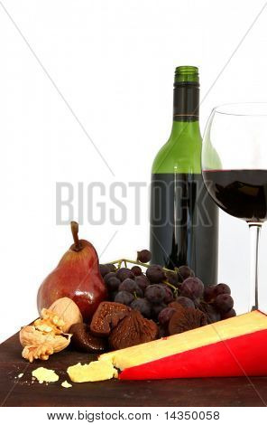 Red wine, with board of cheese, grapes, figs, pear and walnuts.  White background.