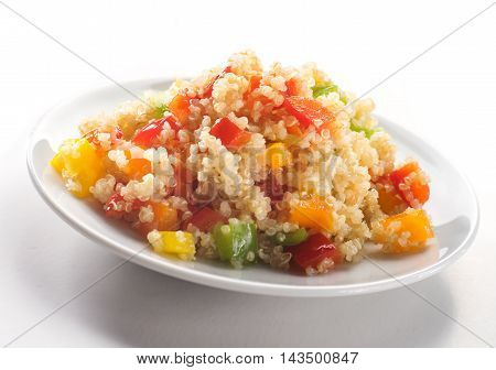 Close up of colorful quinoa salad with vegetables isolated on white backgrorund