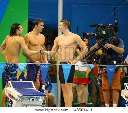 RIO DE JANEIRO, BRAZIL - AUGUST 13, 2016: USA Men's 4x100m medley relay team Cory Miller (L),  Michael Phelps and Ryan Murphy  celebrate victory at the Rio 2016 Olympic Games