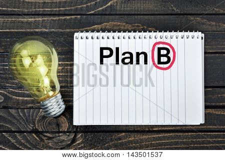 Plan B text on notepad and light bulb