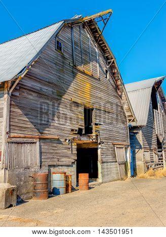 A view of an old weatherbeaten barn in Auburn Washington. HDR image.