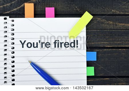 You're fired word on notepad and pen