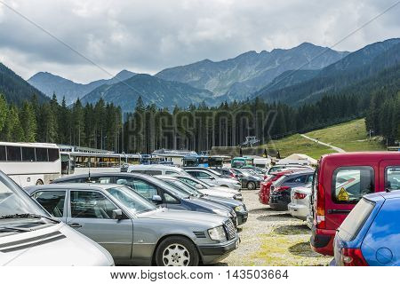 Zuberec Slovakia - August 20 2016: Cars and buses in the parking lot under the hood (Rohace - Spalena Tatra west) of the summer in the mountains.