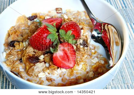 Breakfast cereal with fresh strawberries.