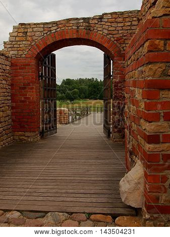 Gates castle. Inowlodz, Poland - July 16, 2016 Gate and walls of brick and stone sand, the reconstructed medieval castle built by the Polish king Casimir the Great in Inowlodz.