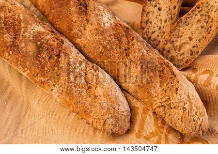 Fresh home baked Alpine Baguettes with Pumpkin Sesame Chia Flax Seeds and rye sourdough starter. Healthy food concept.