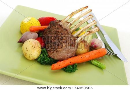 Rack of lamb with mustard and rosemary, and roasted vegetables.  Yummy!
