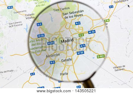 Ostersund, Sweden - Aug 21, 2016: Madrid on Google Maps under a magnifying glass. Madrid is the capital city of Spain