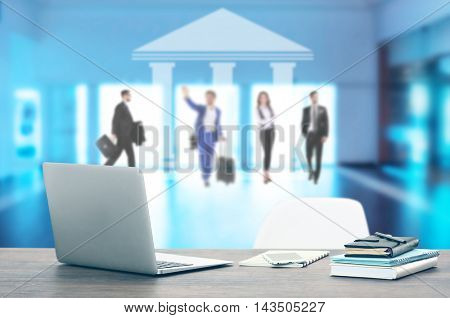 Law concept. Lawyer workplace with laptop. Blurred people silhouettes on background.