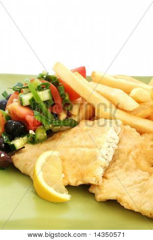A meal of fish 'n' chips, with salad.