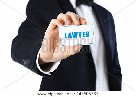 Elegant man in suit holding business card LAWYER, isolated on white