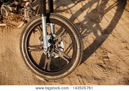 Close up of motorcycle wheel at the desert