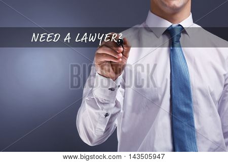 Businessman hand writing on virtual screen. NEED A LAWYER?