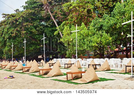 KOH CHANG, THAILAND- APRIL 12, 2015: traditional evening restaurant on beachs sand of Chang island before sunset. Koh Chang is a famous tourist destination in Thailand