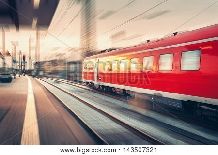 Modern High Speed Red Passenger Commuter Train. Railway Station
