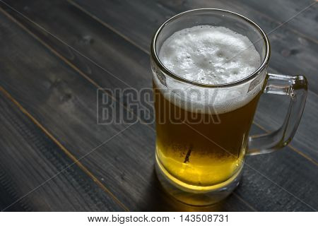 glass beer on wooden background with copy space