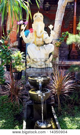 Ganesh, the elephant-headed god of wisdom, prosperity and good fortune.  In a Balinese garden.