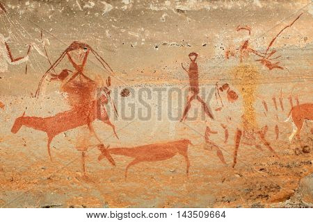 Bushmen (san) rock painting of humans and antelopes, Drakensberg mountains, South Africa