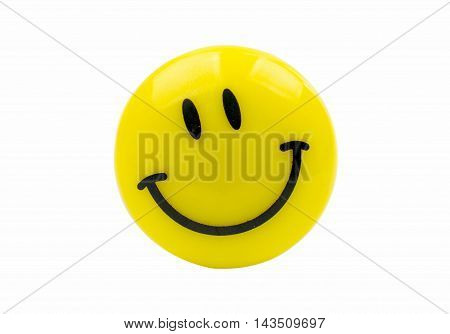 magnet yellow smiley on a white background
