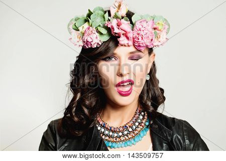 Cute Woman Winking. Fashion Makeup and Hairstyle