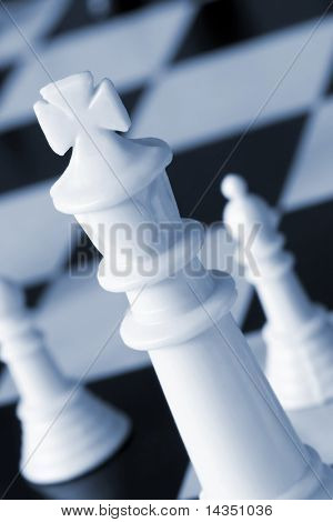 Chessboard with focus on the white king.  Duotone, with soft focus.