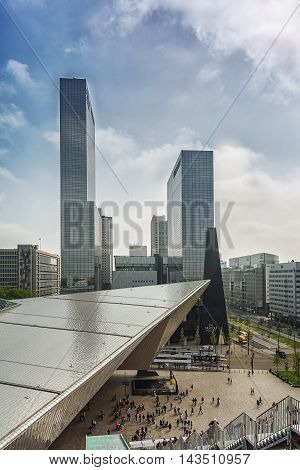 Rotterdam, Netherlands - May 26: Picture of the front of Rotterdam Central Station in the background the towers of the building Delftse Poort, taken May 26, 2016 in Rotterdam, Netherlands.