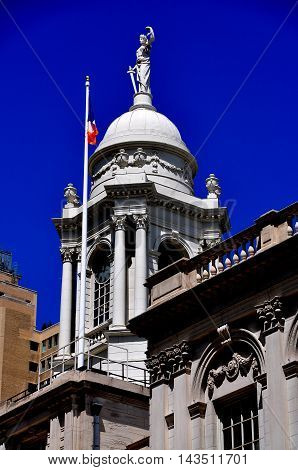 New York City - August 13 2013: The cupola of 1811 City hall topped by a statue of Justice