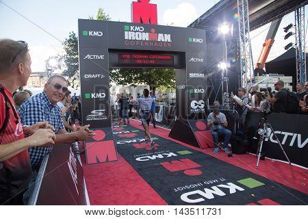 Copenhagen, Denmark - August 21, 2016: Triathlete Alberto Casade crossing the finish line as 4th in men's in  08:12:53 at the KMD Ironman Copenhagen 2016