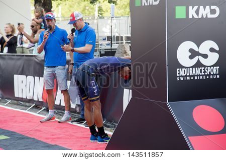 Copenhagen, Denmark - August 21, 2016: An exhausted Igor Amorelli just after crossing the finish line as 5th in men's in 08:13:02 at the KMD Ironman Copenhagen 2016