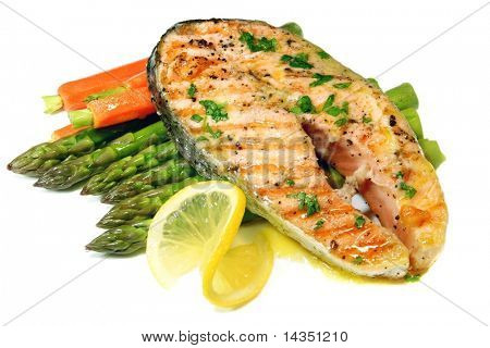 Grilled salmon cutlet with asparagus and baby carrots, and a butter and parsley sauce.