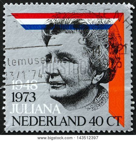 NETHERLANDS - CIRCA 1973: a stamp printed in Netherlands shows Queen Juliana Dutch and House of Orange Colors circa 1973
