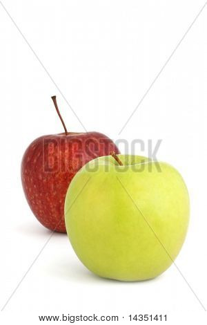 Two apples ~ a red delicious and a golden delicious, casting shadow on white background.