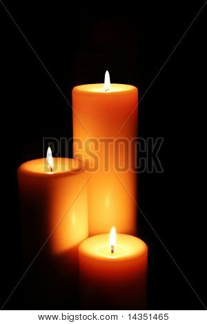 Soft-glowing candles light the darkness.