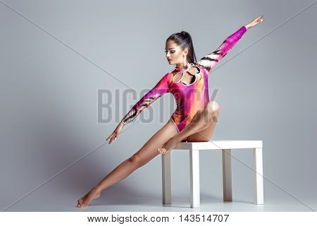 sexy woman in bodysuit with perfect sporty body posing. beautiful gymnast