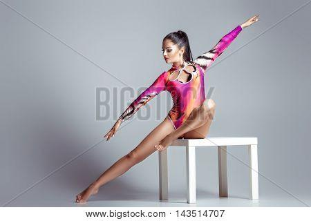 sexy woman in bodysuit with perfect sporty body posing. beautiful gymnast