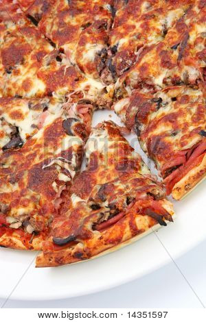 Pizza with mozzarella, olives, ham, anchovies, mushrooms and tomato sauce.