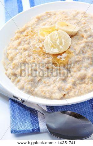 Porridge with banana and honey.  Healthy oatmeal breakfast.