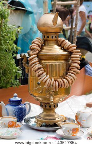 Russian national cutlery samovar is on the table