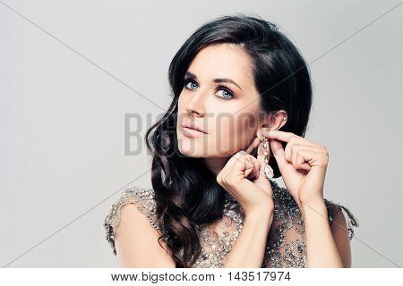 Fashionable beatiful Brunette Woman with Diamond Earrings