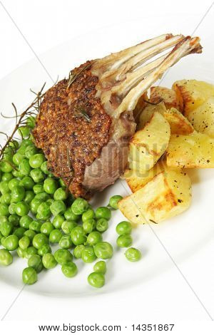 Rack of lamb with seeded mustard and rosemary, served with roasted potatoes and fresh shelled peas
