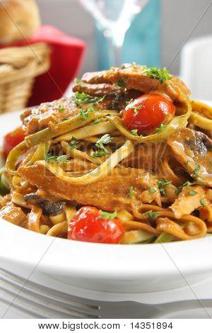 Linguine with a tuna, mushroom and tomato creamy sauce.  Delicious vegetarian pasta.