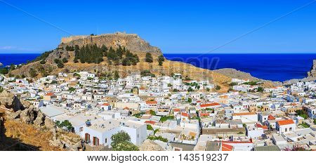 panorama of city of Lindos on Rhodes. Aerial view of buildings and acropolis